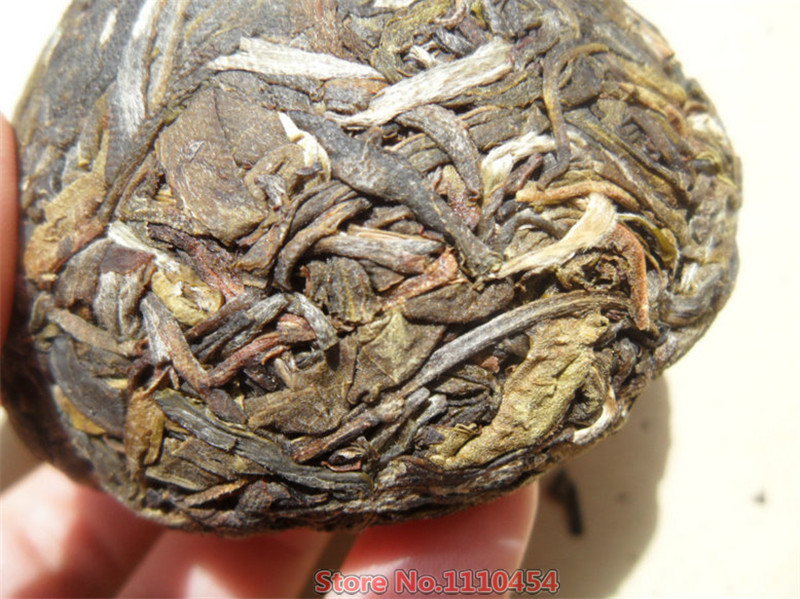 Yunnan Pu'er tea raw puer tea 100g puerh tuo cha pu erh old tree pu er tea green food China resistant brewing bright color sweet